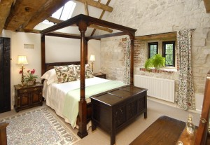 Four poster room at the Stables