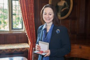 Dr Sandy Lerner with her OBE