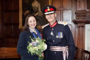 Dr Sandy Lerner and HM Lord-Lieutenant of Hampshire, Nigel Atkinson Esq at the presentaion of her OBE