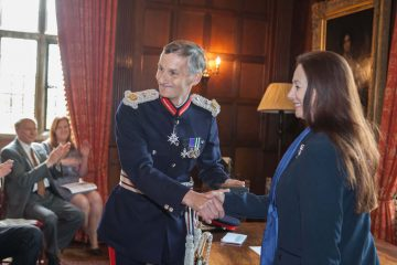 Founder Sandy Lerner receiving her honorary OBE